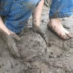 Child making a mud pie